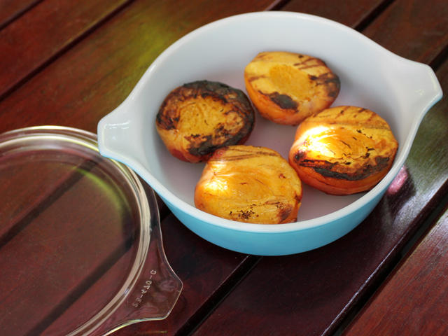 grilled peaches cool in covered dish after cooking to release juices