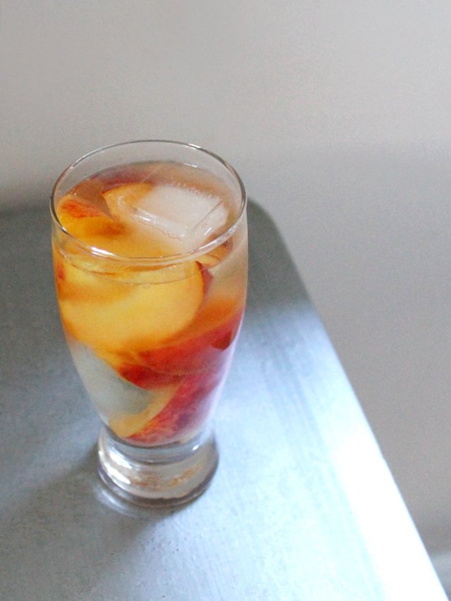 light wine cocktail made with bubbly wine water and peaches muscato d asti batasiolo bosc dla rei