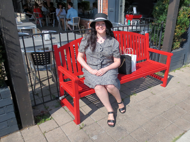 sitting-on-a-red-bench