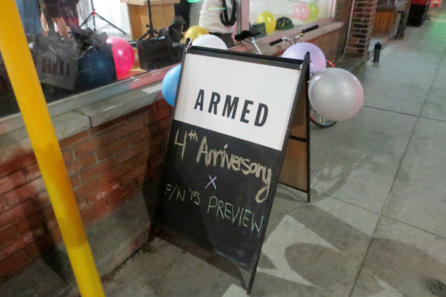 armed-jewelry-fourth-anniversary-party-sign