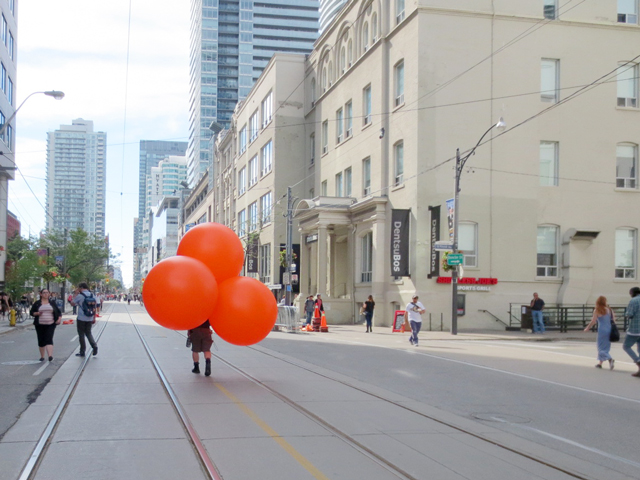 big-orange-balloons-being-set-out-for-tiff-street-festival