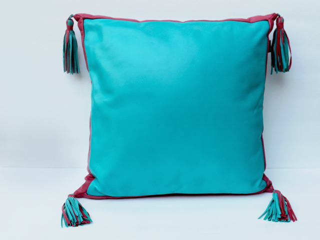 leather throw pillow turquoise and pink from thrift store