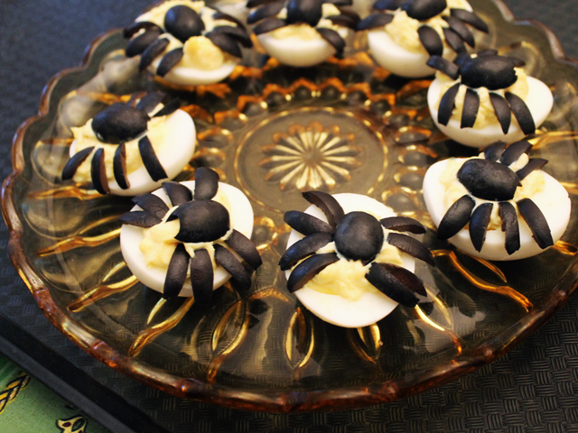 halloween deviled eggs with spiders made from black olives party food