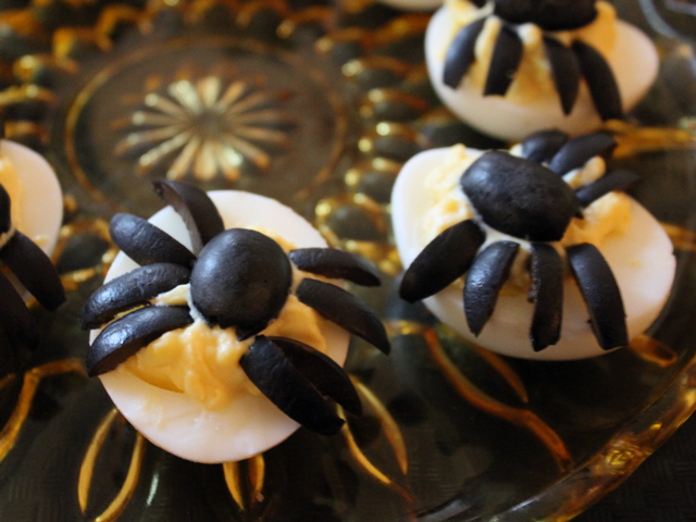 halloween party food deviled eggs with spiders on them