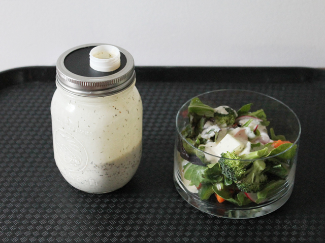 homemade salad dressing in a mason jar with an added pouring spout