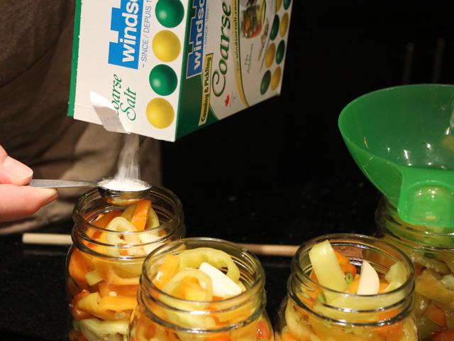 making-hot-pickled-pepper-rings-adding-pickling-salt