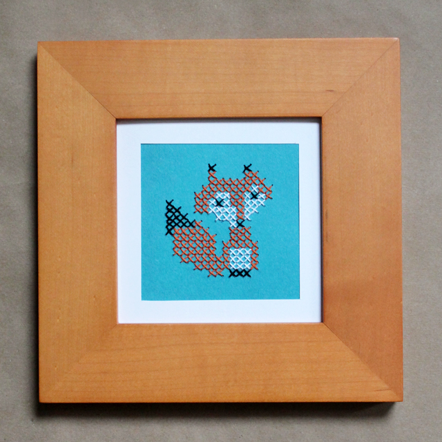 handmade fox cross stitched on paper in frame
