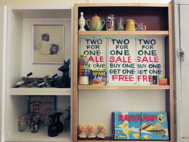 cupboard displaying vintage things