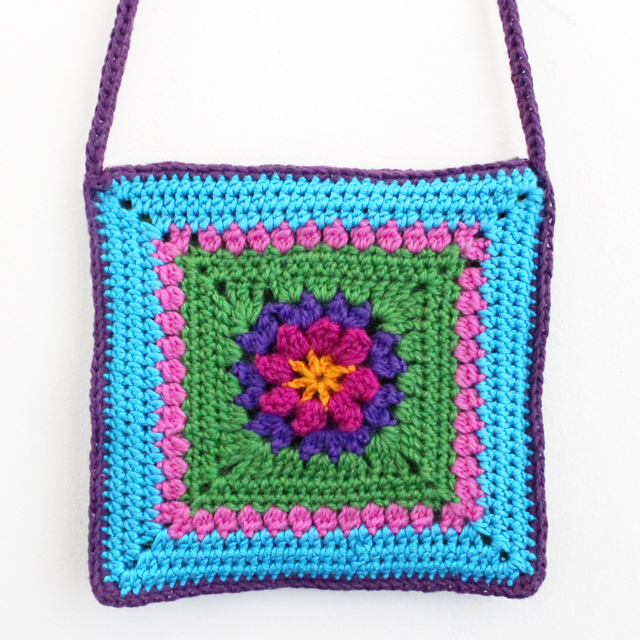 handmade crocheted bag purse for a child based on dadas place primavera flower granny square
