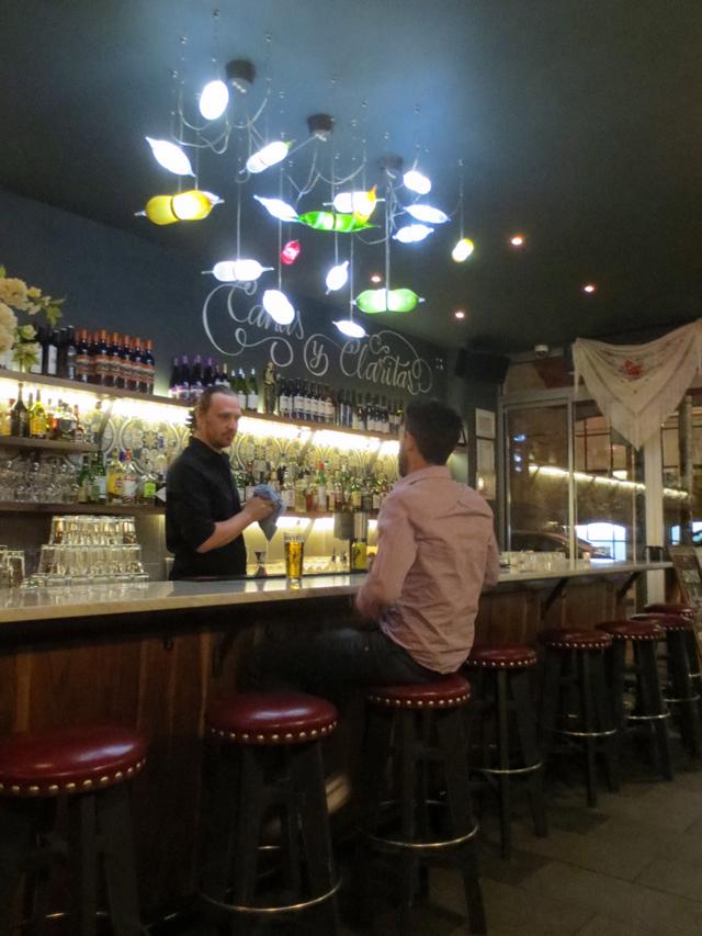 bar area at carmen restaurant queen street west