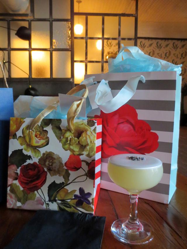 birthday celebration gifts and a cocktail