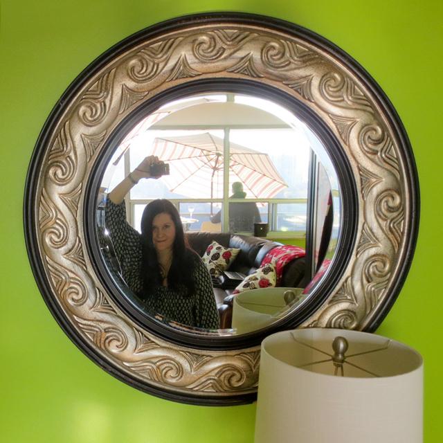 selfie in a round mirror