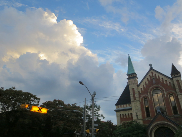dramatic clouds and church