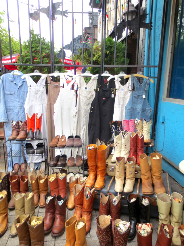 vintage cowboy boots and overalls at courage my love in kensington market toronto