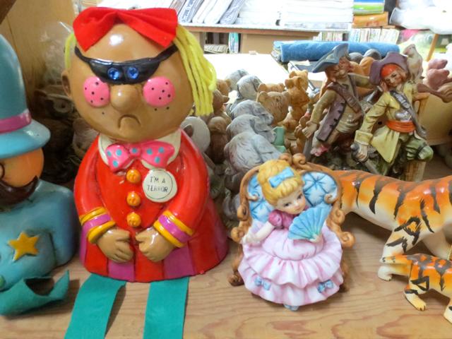 vintage figurines in smart wear kensington market