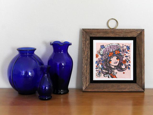 vintage tile artwork with cobalt vases