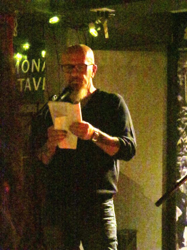 poet-reading-his-work