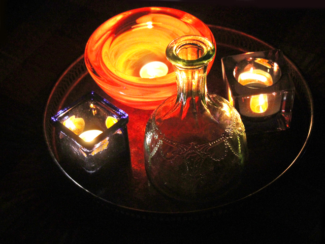 candles in coloured glass