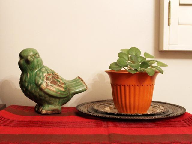 ceramic bird and plant