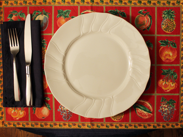 table setting with thrifted linens and vintage cutlery