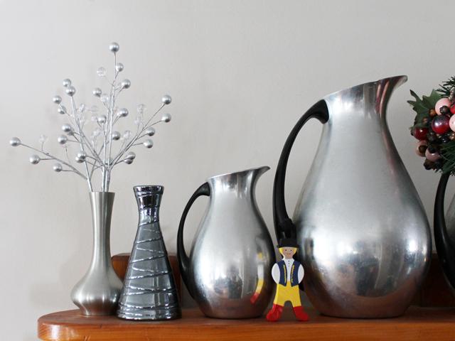 shelf with vintage aluminum jugs
