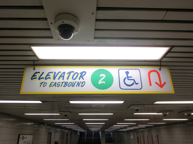 art installation in bathurst subway station toronto honest ed style signs