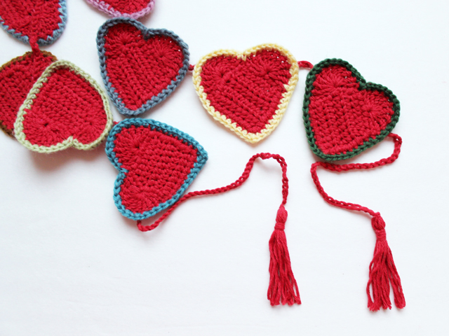completed crochet heart garland banner with tassel ends free pattern how to make