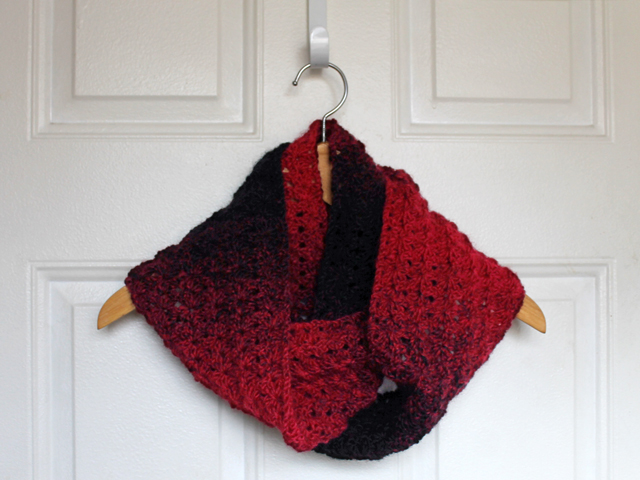 crocheted cowl scarf made with one skein lion brand scarfie yarn cranberry black free pattern