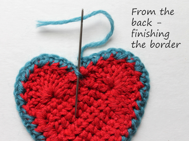 crocheted heart finishing the border seen from the back