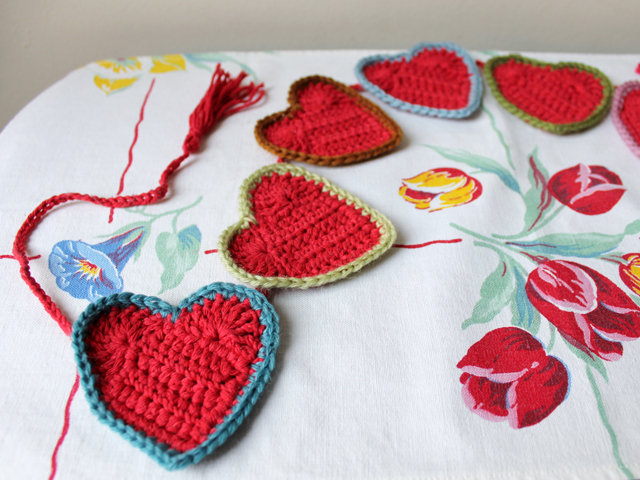 crocheted heart shaped garland banner decoration colours chosen from vintage fabric