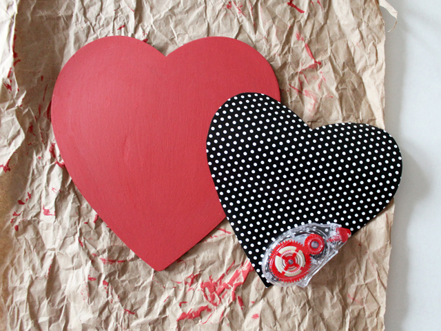 cut out smaller heart from patterned paper and apply with glue strip