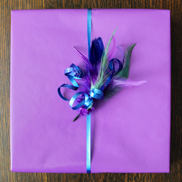 gift wrap with easy to make feather gift topper and curling ribbon