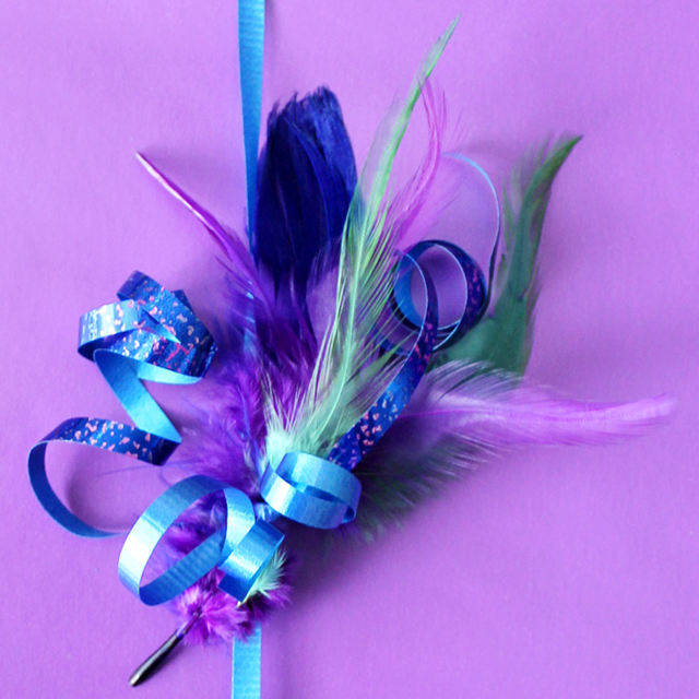 handmade gift topper with coloured feathers and curling ribbon diy