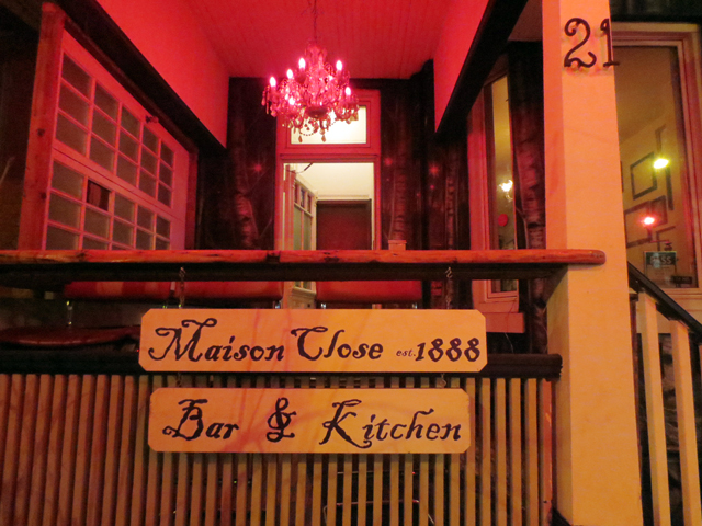 maison close 1888 sign kensington market toronto restaurant