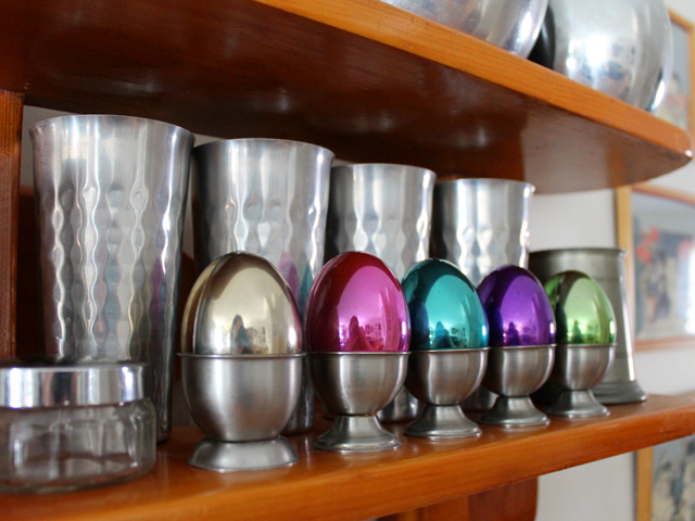 metallic easter eggs in vintage eggcups