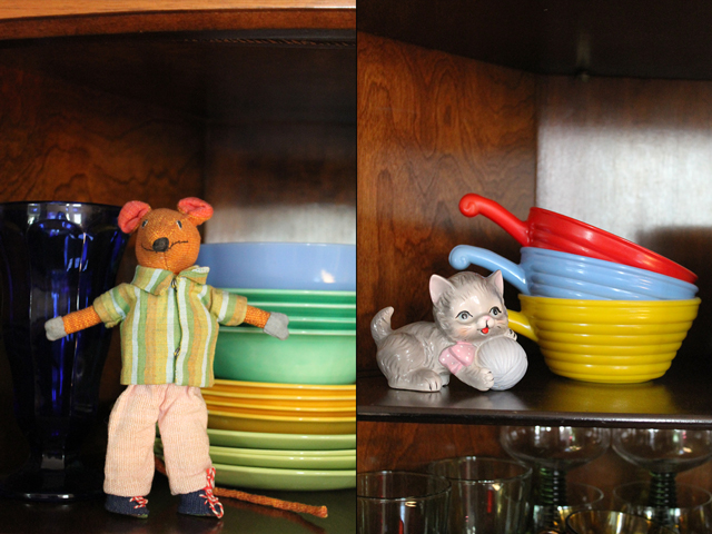 vintage coloured dishes in cabinet