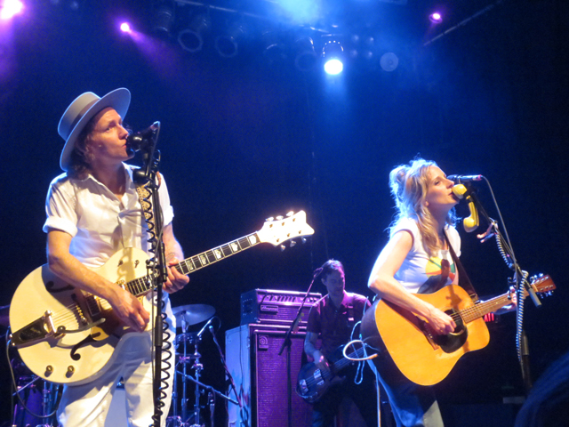whitehorse band singing into vintage telephone receivers at the phoenix toronto