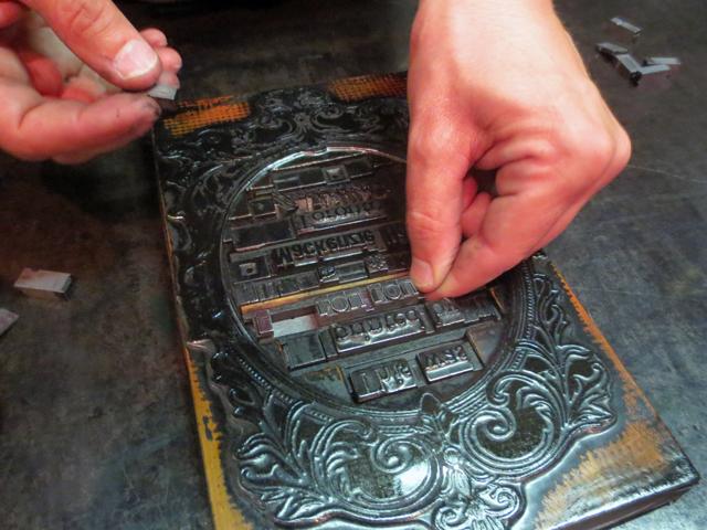 using historic printing press at mackenzie house toronto