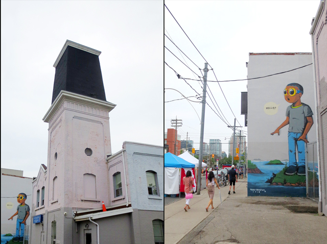 historic building and hello mural on ossington avenue toronto during ossfest