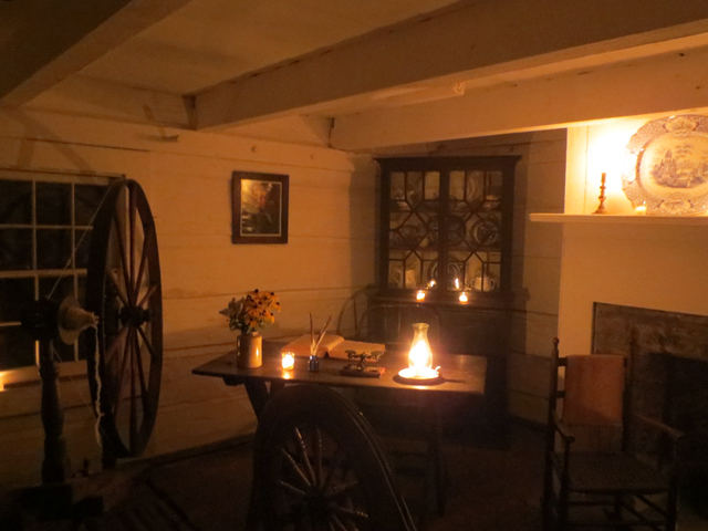 inside scadding cabin at night on cne grounds torontos oldest house