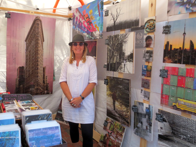 photographer melissa kristensen smith with her work printed on reclaimed wood at artfest ontario in distillery district toronto