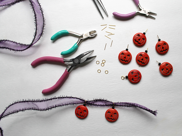 making halloween garland decoration with pumpkin beads
