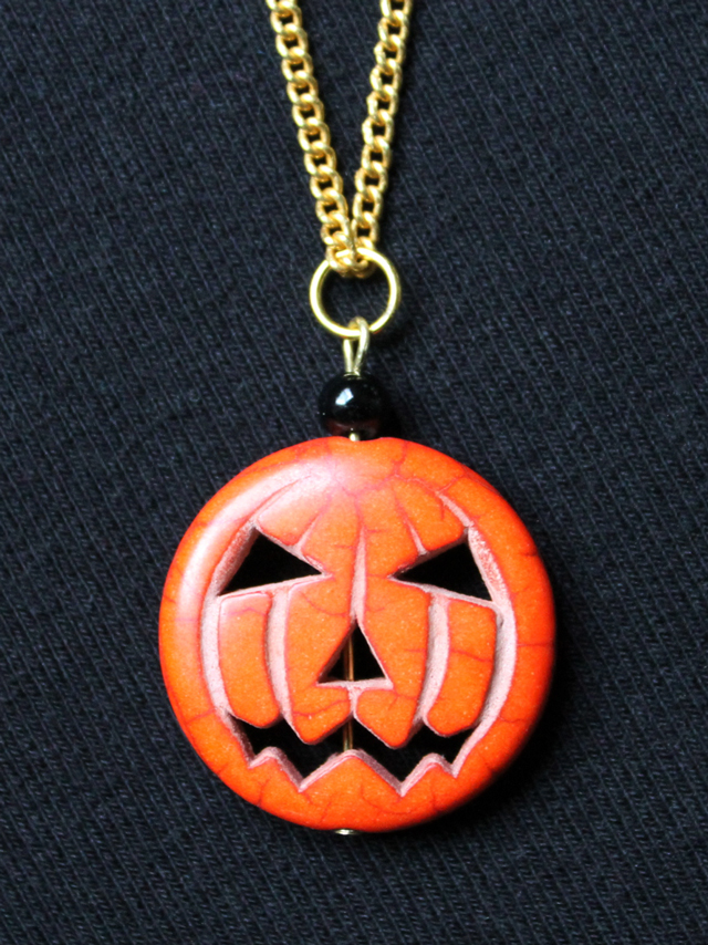 pendant made with jack o lantern pumpkin bead from bead gallery found at michaels
