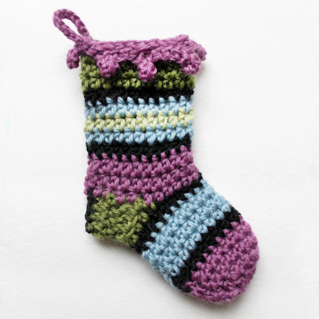 crochet mini stocking from lemondedesucrette free pattern with added trim and shorter foot part