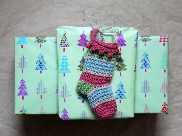crocheted mini stocking used as christmas gift topper decoration free pattern