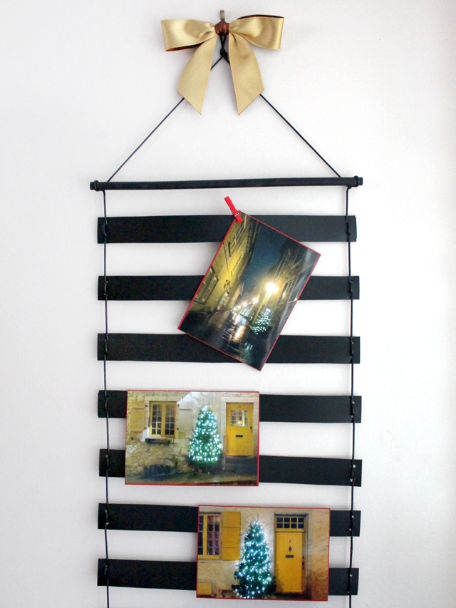 handmade greeting cards displayed on handmade card holder wall hanging