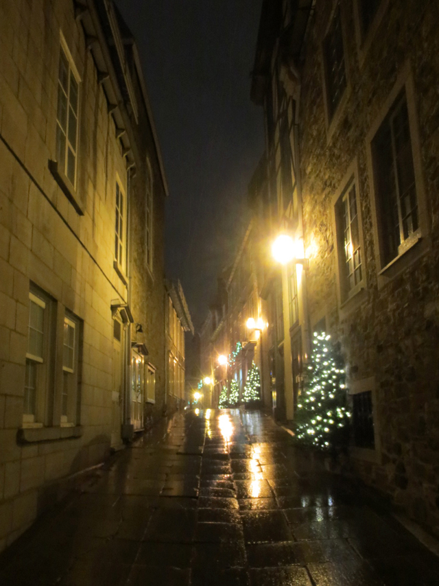 narrow street in the rain old quebec city