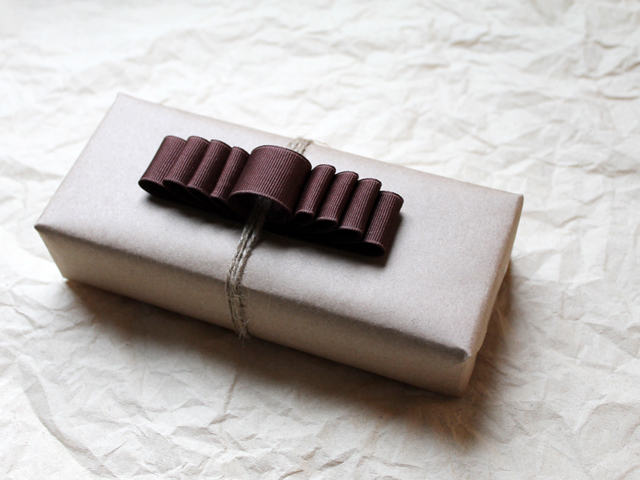 rustic looking gift wrapping with handmade ribbon bow