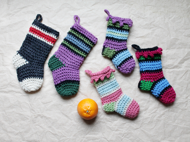 small and mini christmas stockings crochet free patterns with clementine for scale