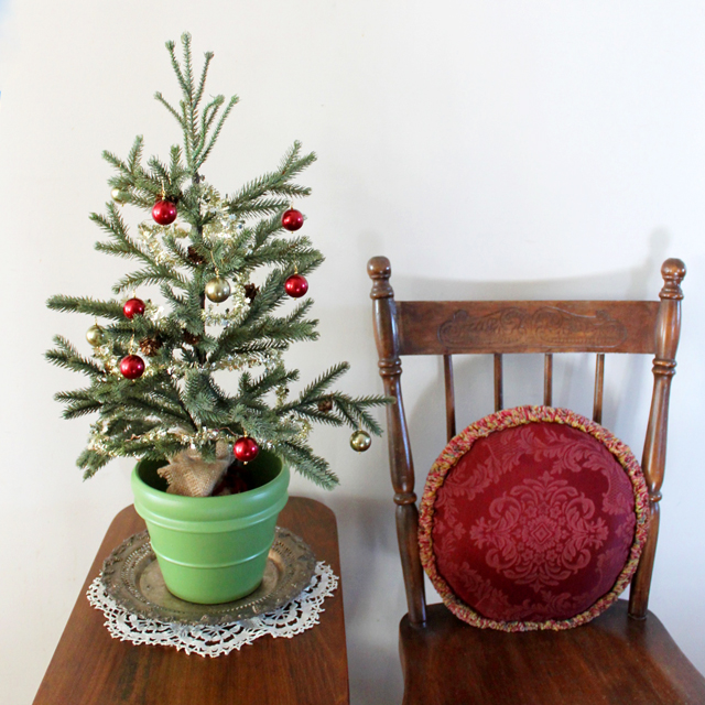 small christmas tree decorated with handmade baubles